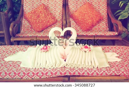 Valentine day background. Two towel made in heart swan shape. Vintage filter. - stock photo