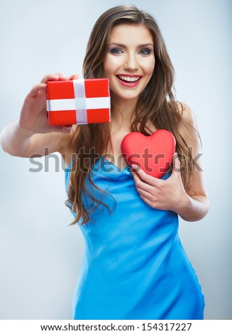 Valentine day concept, woman hold red heart, gift box. Isolated studio background female model. - stock photo