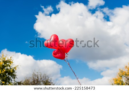 Valentine heart balloon against blue sky background - stock photo