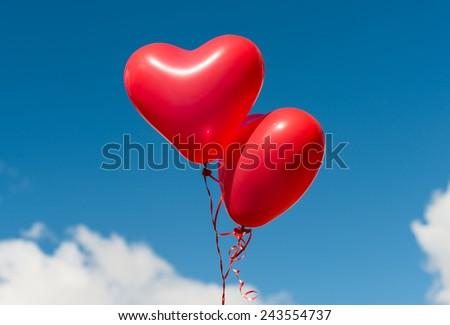 Valentine heart balloon against blue sky background - stock photo