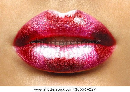 Valentine Heart Kiss on the Lips. Makeup. Beauty Sexy Lips with Heart Shape paint. Valentines Day. Beautiful Love Make-up  - stock photo