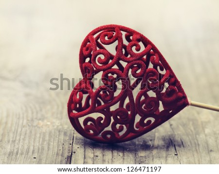 Valentine heart on rustic wooden background - stock photo