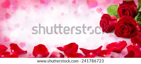 valentine invitation with hearts with petals and bloom of red roses  - stock photo