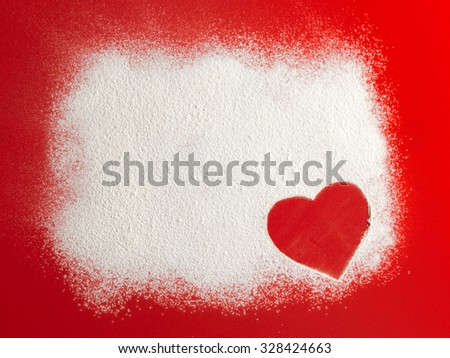 Valentine love red heart shape in snow on red background. Closeup.Christmas card. - stock photo