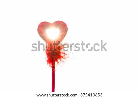 Valentine love symbol against bright sunlight isolated in white background - stock photo