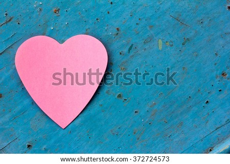 Valentine - paper pink heart against a blue painted surface. Copy space. Free space for text, Close-up, top view - stock photo