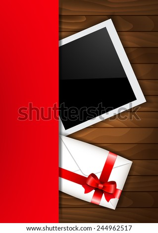 Valentine photo frame on a wooden background   - stock photo