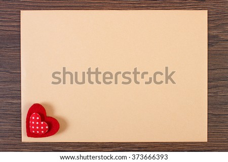 Valentine red heart and love letter in envelope on wooden background, decoration for Valentines Day, symbol of love, copy space for text - stock photo