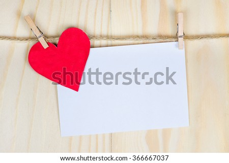 valentine's day card hanging with a rope. for input your text here - stock photo