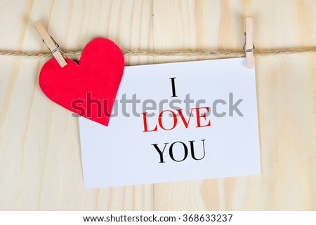 valentine's day card hanging with i love you - stock photo
