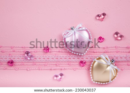 Valentine's day card  with two hearts and laces on pink background - stock photo