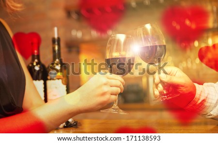 Valentine's Day concept couple having dinner and drinking wine - stock photo
