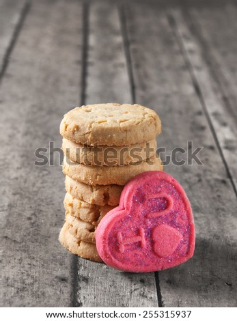 valentine's day cookies on a wooden bench - stock photo