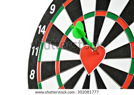 Valentine's Day heart: Heart and arrow on dart board (love concept) - stock photo