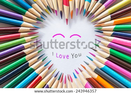 Valentine's day love concept with colored pencils : Love is colorful ; I love you - stock photo