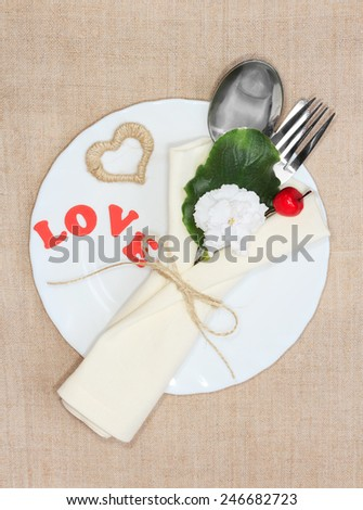 Valentine's Day love inscription on plate with silverware - stock photo