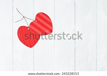 Valentine's Day paper hearts tied together with room for copy space. - stock photo