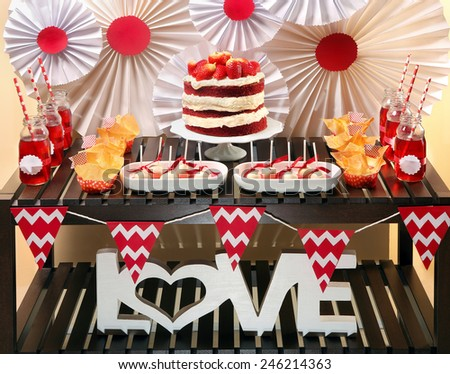 Valentine's Day party table with red velvet cake - stock photo