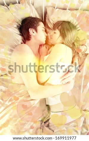 Valentine's Day. Romantic dreams. Young couple sleeping in a bed - stock photo