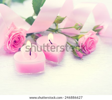 Valentine's Day. Valentine Gift. Pink Heart shaped candles and rose flowers on white wooden background. Beautiful Valentine card art design - stock photo