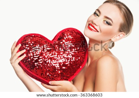 Valentine's Day. Woman holding Valentines Day heart - stock photo