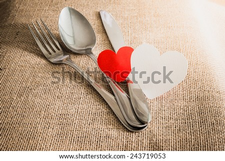 Valentine's Romantic Dinner concept with silverware on sackcloth textures - stock photo