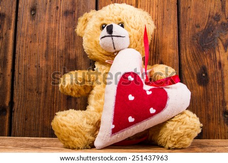 Valentine teddy bear and heart - stock photo