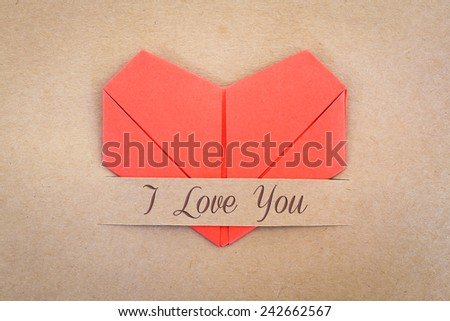"Valentines card, The red heart shape paper on brown with ""I love you"" label - stock photo"