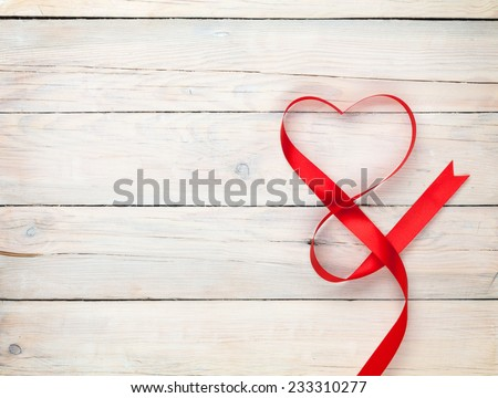 Valentines day background with heart shaped ribbon over white wooden table background - stock photo