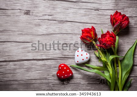 Valentines Day background with hearts and red tulips - stock photo