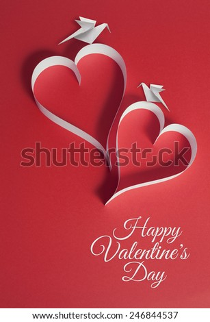 valentines day background with origami birds and paper cut hearts. - stock photo