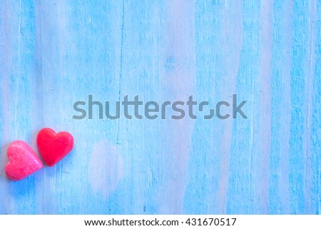 Valentines Day background with shugar valentine heart on blue painted wood table.Retro filter. - stock photo