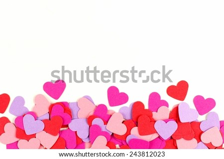 Valentines Day border of colorful paper hearts over white - stock photo