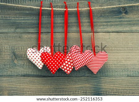 Valentines Day Decoration Red Hearts On Wooden Background. Vintage style toned picture - stock photo