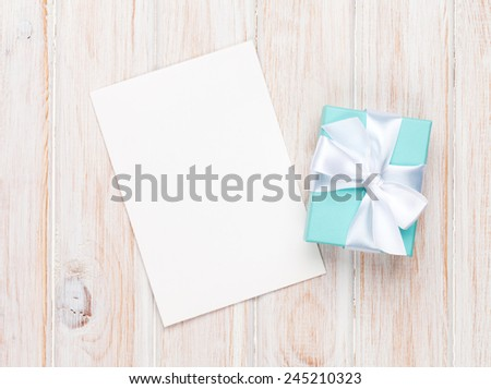 Valentines day gift box and greeting card on white wooden table with copy space - stock photo