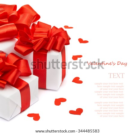 Valentines Day Gifts wrapped in white paper with red satin ribbon hearts isolated on white background - stock photo