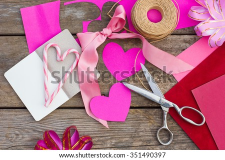 valentines day, handicrafts made of paper. Wood background - stock photo