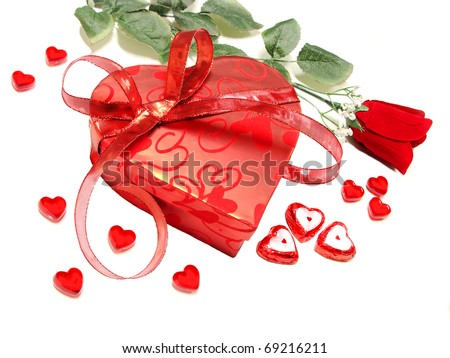 Valentines Day - heart-shaped box with rose, chocolates and gems - stock photo