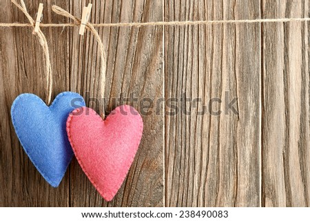 Valentines Day. Hearts Handmade Couple, hanging on rope. Love concept on wooden background - stock photo