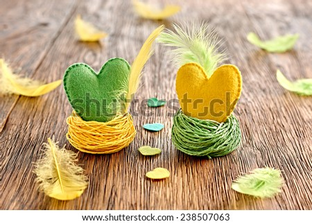 Valentines Day. Hearts Handmade Couple with feathers in Nests. Love concept on wood. Retro - stock photo