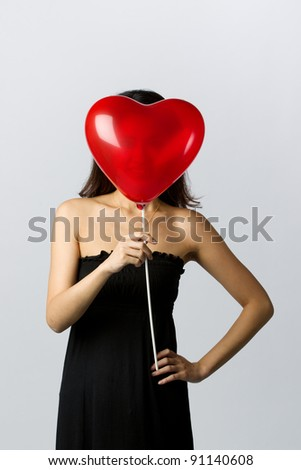 Valentines day image of a young Asian woman - stock photo