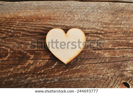 Valentines Day old retro vintage aged texture background with one alone wooden heart.Close up of sign made from whole wood Empty copy space for inscription Idea of feelings of love - stock photo