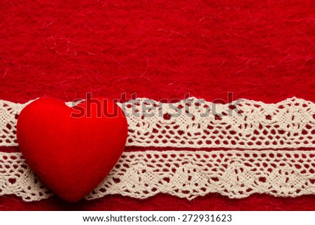 Valentines day or wedding concept. Big decorative heart lace ribbon on abstract red cloth background. Border frame. - stock photo