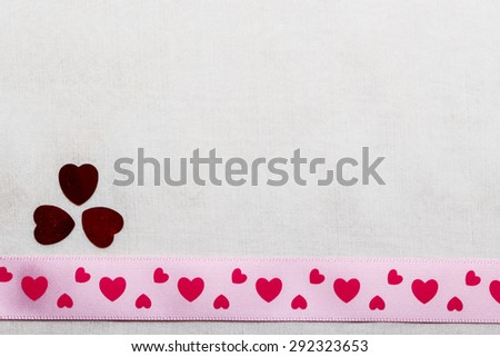 Valentines day or wedding concept. Pink heart satin ribbon on abstract white cloth background, copy space. Border design - stock photo