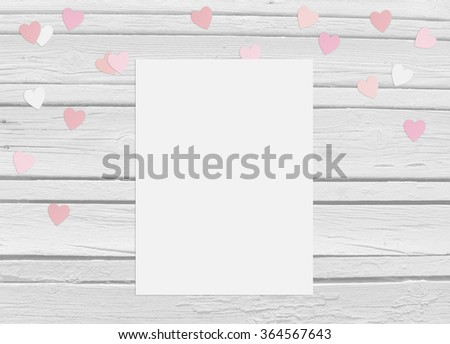 Valentines day or wedding mockup scene with blank card, paper hearts confetti and wooden background, empty space for your text, top view - stock photo