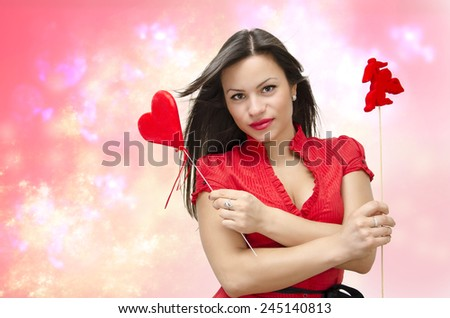 Valentines day photo manipulation, cute sexy girl holding heart and cupid on stick, abstract, magical background  - stock photo