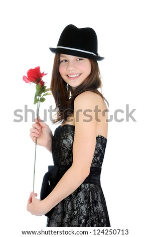 Valentines day. Portrait of a young and beautiful girl with rose isolated on the white background - stock photo