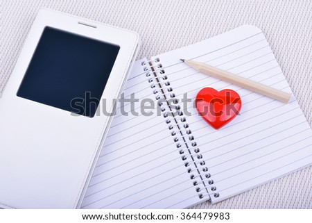 Valentines day red heart, smartphone and notebook - stock photo