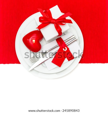 Valentines Day table place setting in Red and White. Festive romantic decoration with candle heart - stock photo