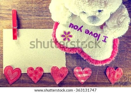 Valentines Day. Teddy Bear Loving cute with red hearts sitting alone. Vintage. Retro romantic styled on wooden background. Copyspase - stock photo